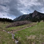 Spring runoff in the meadow beneath the Flatirons.