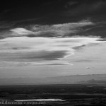 Lenticular clouds forming up, with Chatfield Reservior in the foreground