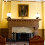 The lobby fireplace with a painting of Walter Deveraux, weathy banker that established the hotel.