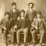 "This image is known as the ""Fort Worth Five Photograph.""  Front row left to right: Harry A. Longabaugh, alias the Sundance Kid, Ben Kilpatrick, alias the Tall Texan, Robert Leroy Parker, alias Butch Cassidy; Standing: Will Carver & Harvey Logan, alias Kid Curry; Fort Worth, Texas, 1900. (courtesy Wikimedia Commons)"